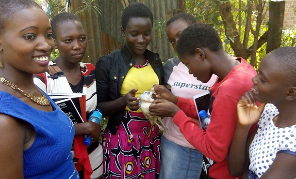 Girl Champion project participants learn how to vaccinate chickens